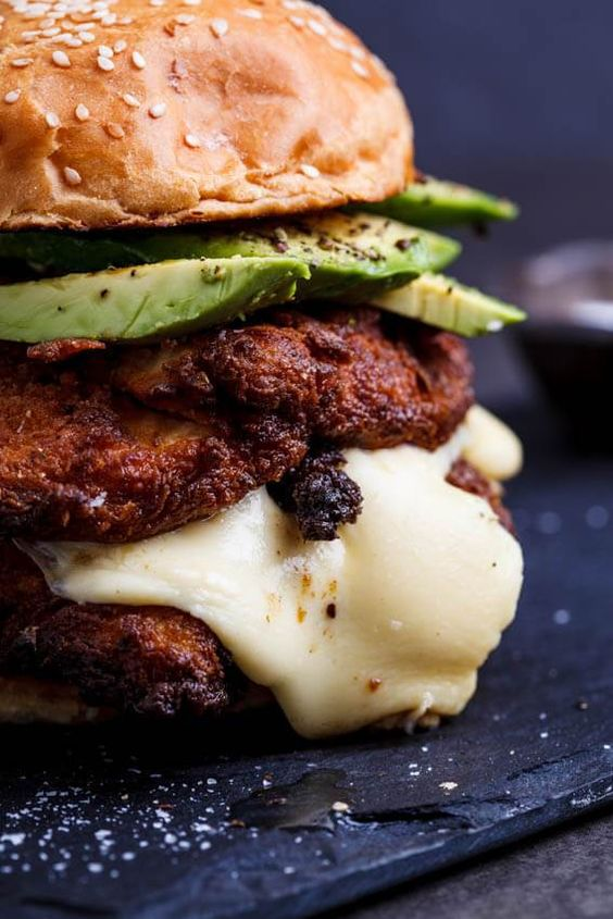 Yep, that chicken is ridiculously crispy. Oh yes, that is half of a perfectly ripe avocado on top. And yup, you guessed it, that's mozzarella just slowly melting it's way down. Is it ridiculously big? You betcha. Is it flipping delicious? Right again!