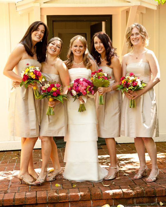 The+bridesmaids+wore+Ann+Taylor+dresses+and+carried+vibrant+bouquets+of+feverfew,+ranunculus,+godetia,+jasmine+vine,+and+garden+roses+made+by+Danielle+Rowe+of+Brown+Paper+Design.The+couple+planned+to+take+most+of+their+portraits+with+their+photographers,+Brooke+and+Nanishka+Duthie+of+B