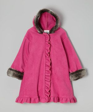 Little ones will stand out from the crowd in this utterly adorable coat. Graced with ruffles and soft faux fur, its roll-down cuffs and washable construction make this piece easy to snuggle up in.