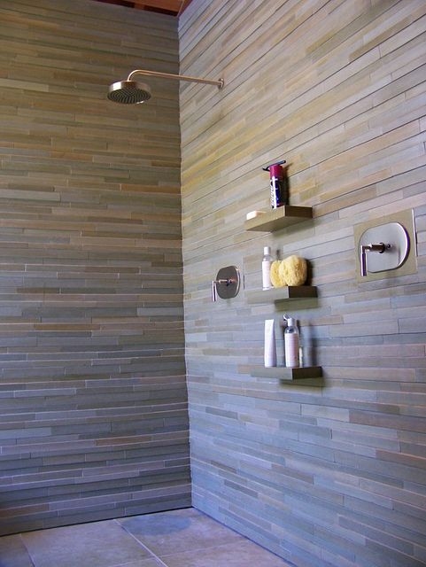 Stacked stone wall shower with shelves by samuel brown for Stacked stone bathroom ideas