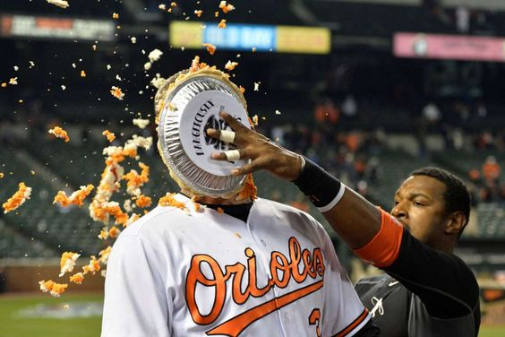Pie in the eye:   Baltimore Orioles center fielder Adam Jones pies catcher Matt Wieters after his walk-off hit against the Minnesota Twins on April 4. The Orioles won 3-2.  -      © Tommy Gilligan/USA TODAY Sports