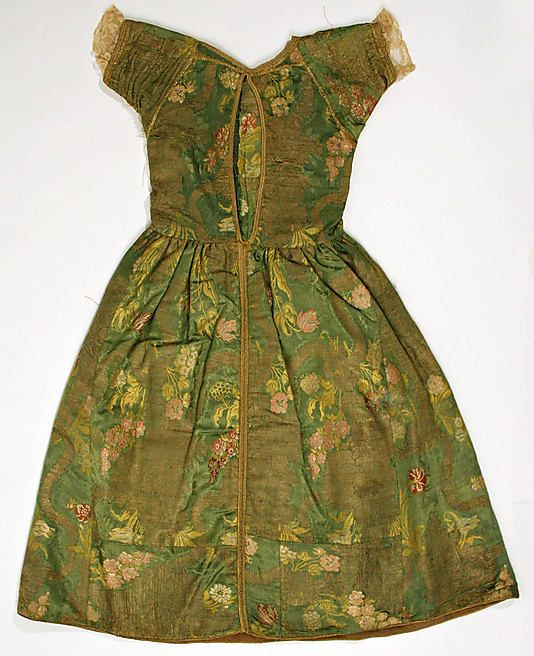 Back view, girl's dress, Italy, 18th century. Silk brocade embroidered with floral motifs on green ground.