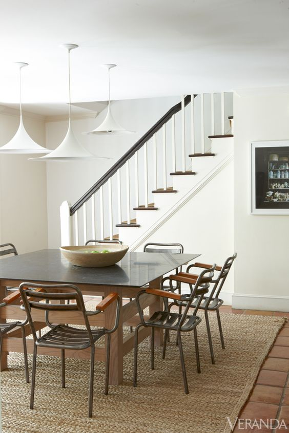 Extra Gravitas: A trio of modern pendants becomes a sculptural element in a dining area.