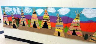The kinders study types of line and make this teepee mural in art.