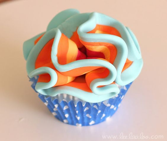 Fondant ruffle...this one is made for a cupcake, but I would put a few together on a large cake:)