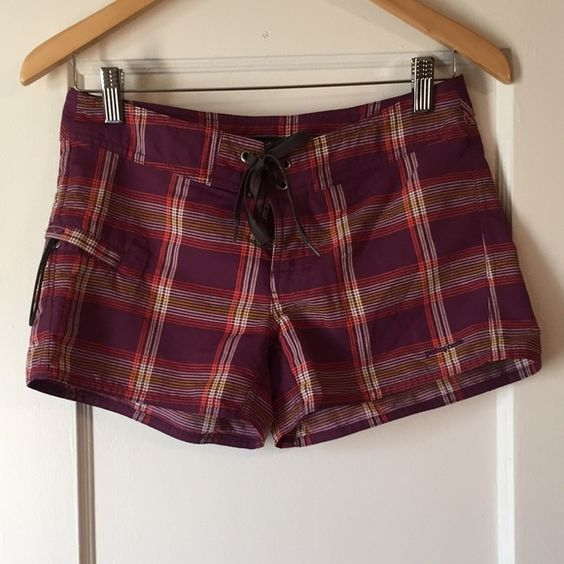 Patagonia Purple Plaid Wavefarer Board Shorts Patagonia plum, coral orange, yellow and white plaid Wavefarer board shorts. Grommet, lace-up and snap fly. Side pocket with button. Very high quality, durable and flattering. 100% nylon. Excellent condition with no noted flaws. No trades, no PP. Priced to sell! Patagonia Shorts