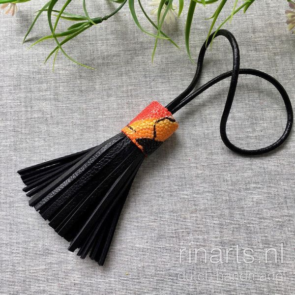 Black leather bag charm with orange stingray too