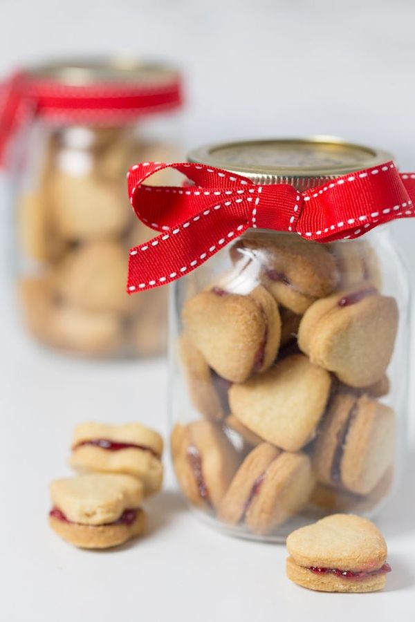 Easy valentine cookies - Buttery shortbread hearts sandwiched with raspberry jam. A gift you'll want to keep to yourself!