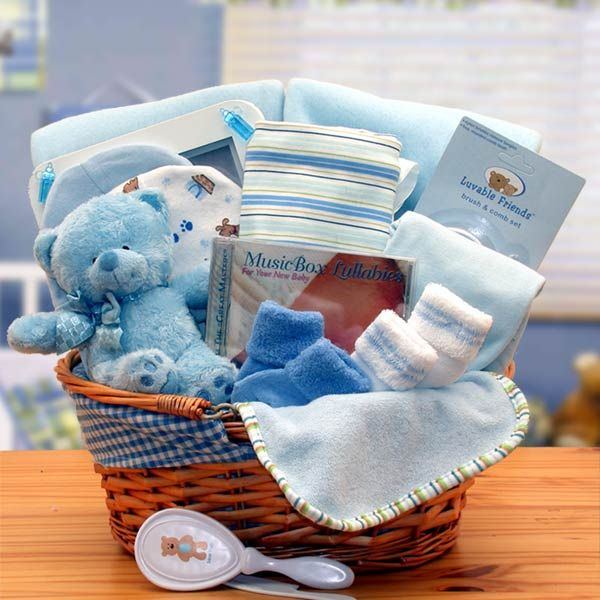 Simply The Baby Basics New Baby Gift Basket-Blue, Celebrate the arrival of a beautiful baby with a generously filled, deluxe fabric lined hamper. It overflows with a collection of select baby necessities any new parent will love. The fabric lined basket makes for great storage in babies room after the gift is used.