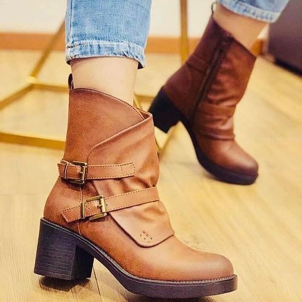 Leather boots with straps heels