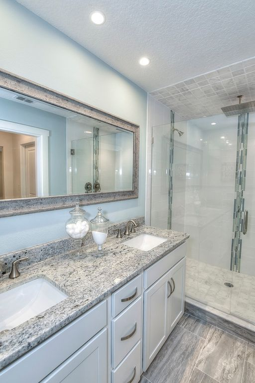 Transitional 3/4 Bathroom with Dallas White Granite, Frameless Shower Doors By Dulles Glass and Mirror, European Cabinets