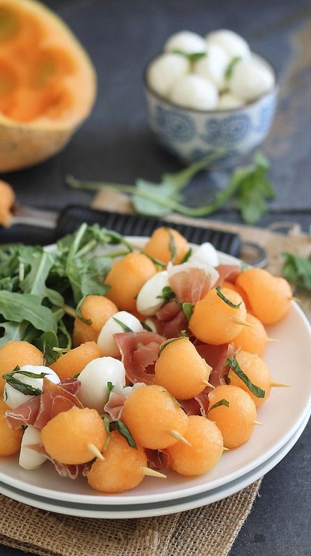 Melon, Prosciutto, and Mozzarella Skewers. I might switch out the prosciutto-- not sure. Great idea for a party.