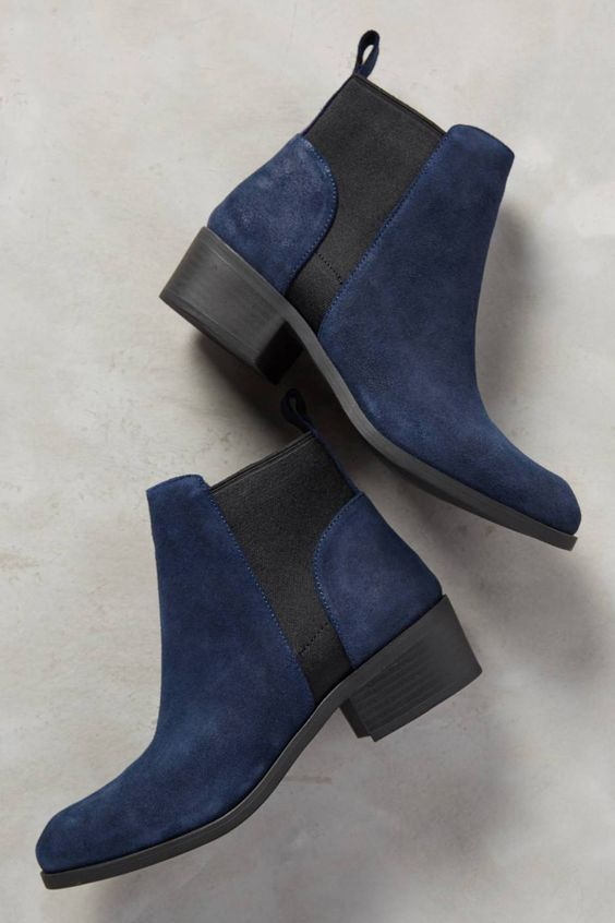 Navy blue suede ankle boots with black inserts