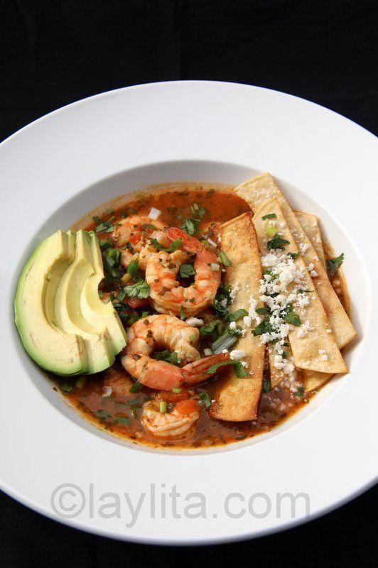 Shrimp soup with avocado, tortilla chips and queso fresco