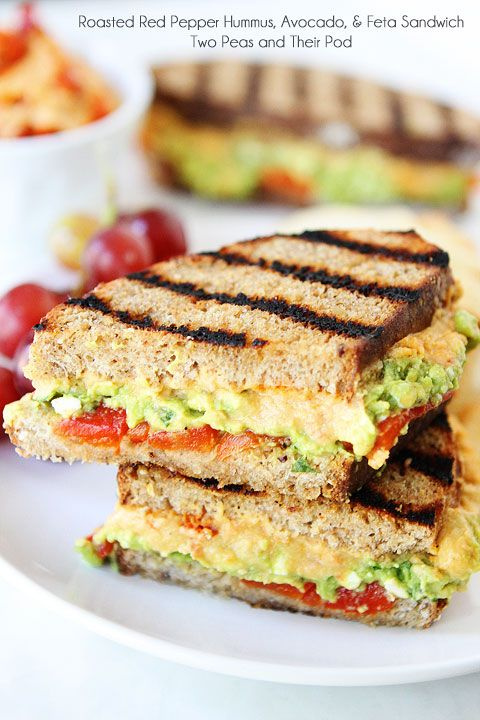 Roasted Red Pepper Hummus, Avocado, & Feta Sandwich Recipe on twopeasandtheirpod.com A simple vegetarian sandwich that is full of flavor!