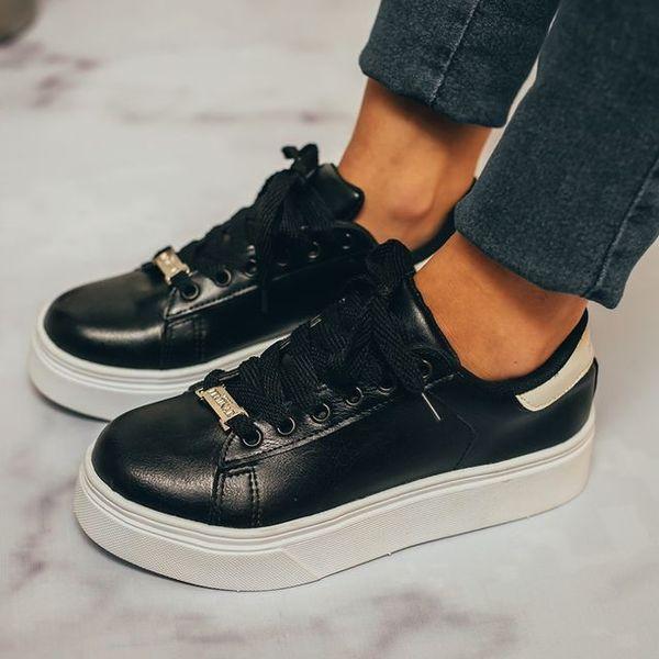 White platform shoes, black top and laces, fashion trend
