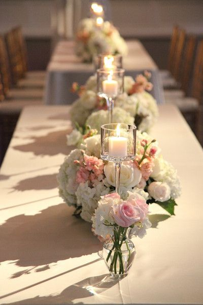 Such a romantic setting for your reception! Love these tall candles + floral #centerpieces. {Yoj Events}