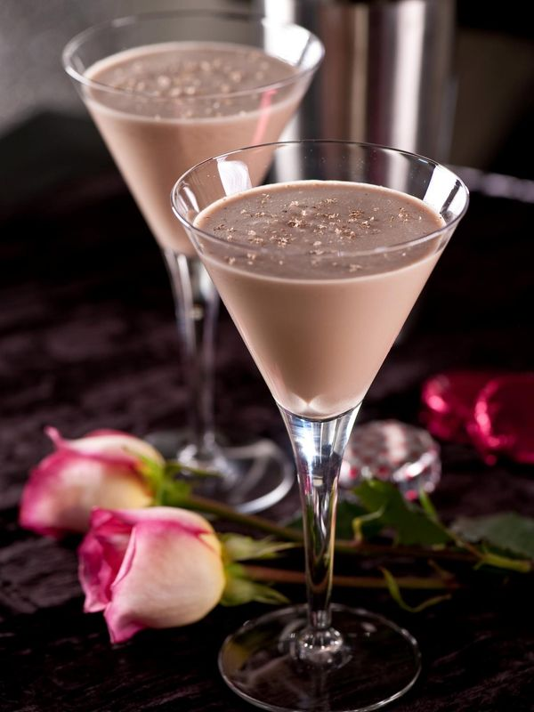VALENTINO'S DELIGHT  1 1/2 oz. bourbon 1 oz. ruby port, the sweeter the better 1 oz. Kahlua 1 1/2 oz. heavy cream Ground nutmeg  Shake all the liquids vigorously with ice for 10 seconds and strain into a martini glass. Sprinkle nutmeg on top and enjoy the creamy goodness.