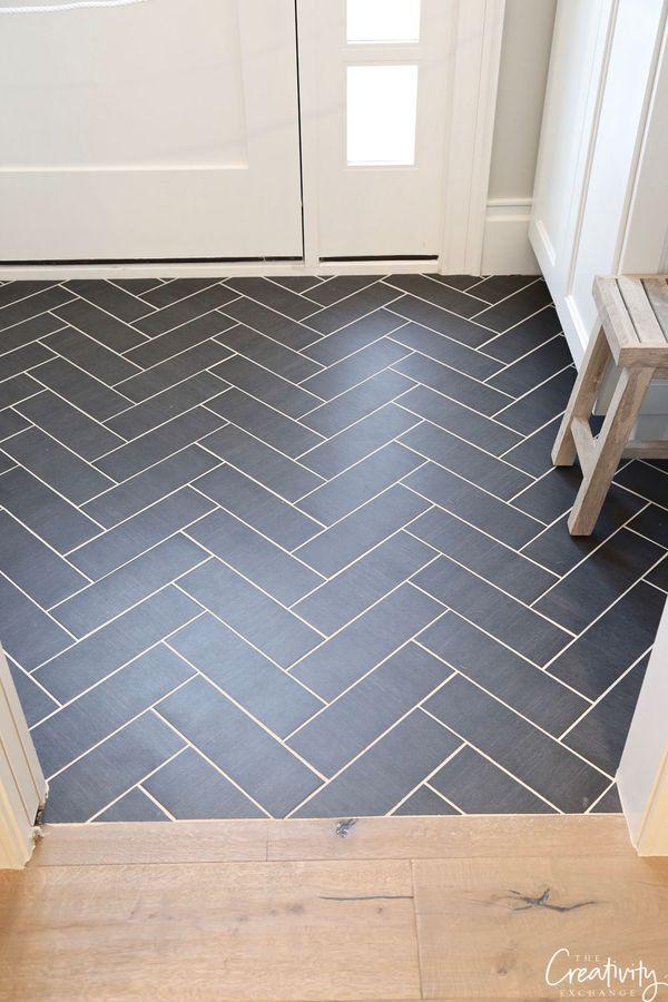 Black slate tile herringbone floor. #tile