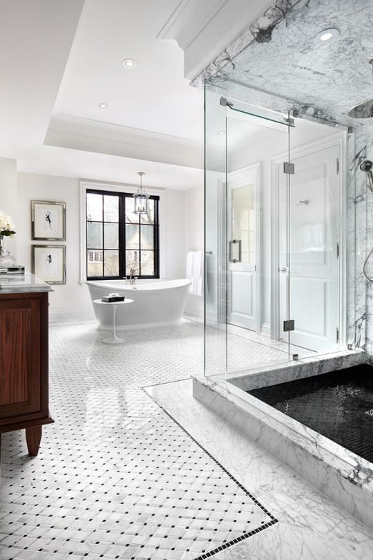 White bathroom with marble bathroom flooring, glass shower and standalone tub. Bathroom ideas, bathroom remodel, small bathroom decorating, bathroom tile, bathroom DIY, bathroom makeover.