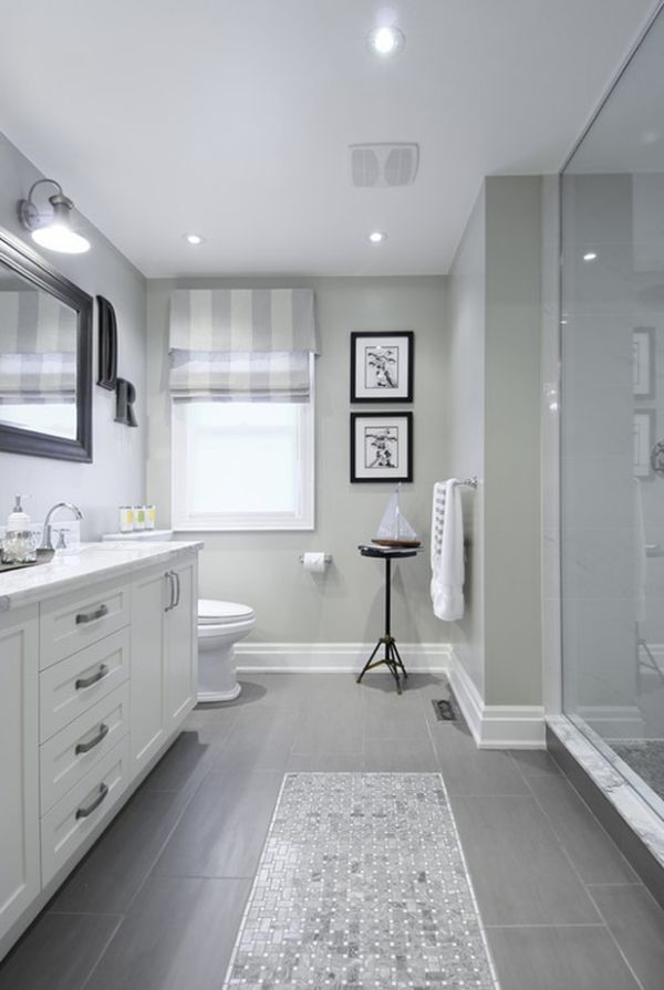 Large tiles on floor, light feel, crown molding around base and windows, large pull handles on drawers