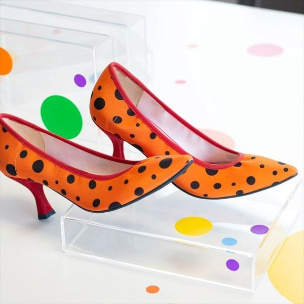 Orange shoes with black polka dots. How cute