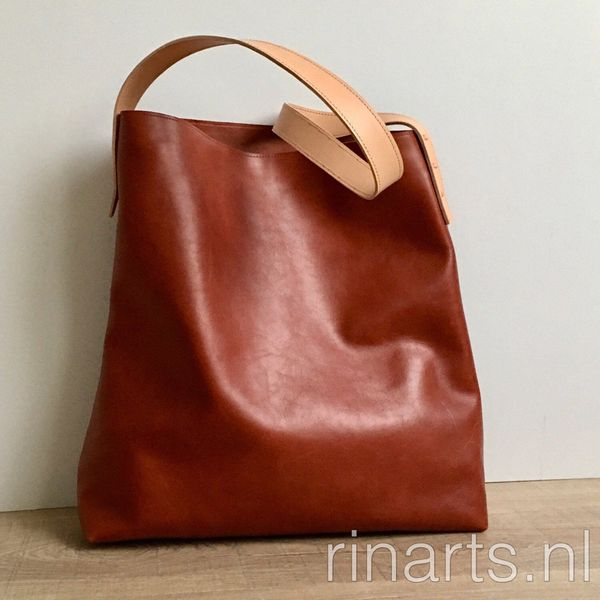 Oversized brown leather tote bag