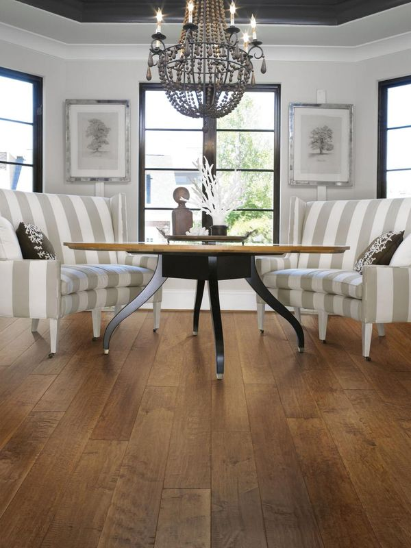 Engineered hardwood is a great choice for open kitchen/dining spaces. This floor uses approximately 50 percent less harvested wood than conventional engineered flooring. Photo courtesy of Shaw Floors
