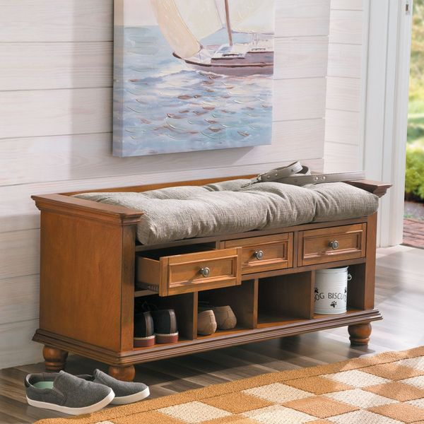 Classic entryway storage bench has cubbies for shoes, drawers for clothes and a comfy bench for seating. A multi-functional apartment furniture piece that's ideal for small spaces.