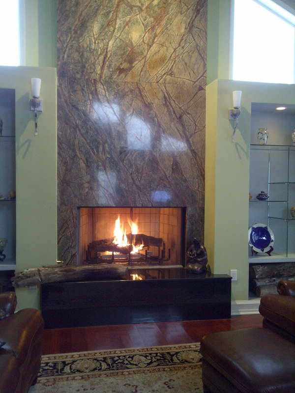 Granite Fireplace Surround.  Different stone and gas but I like the idea