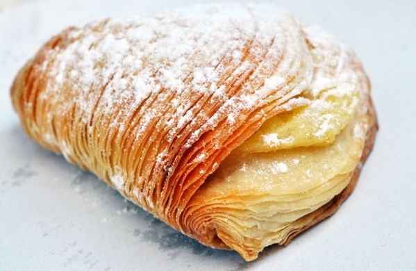 Dessert to die for — Sfogliatella from Napoli — flaky pastry with sweet ricotta, served warm with a cold espresso.  I had this is Italy and wow...it was delish!