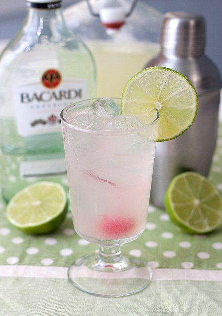 Lime Daiquiris (1/2 cup fresh lime juice  1/2 cup water  1/4 cup granulated sugar  6 ounces light rum   4 marashino cherries  lime wedges)