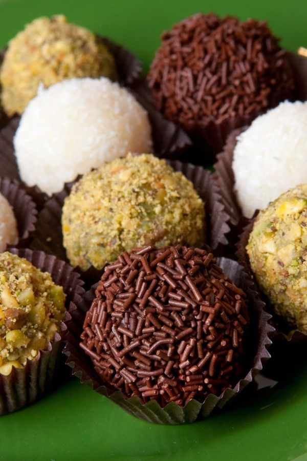 """NYT Cooking: Fudge made from condensed milk is the base for brigadeiros, bite-size sweets served in paper frills and covered with sprinkles. """"Brigadeiros are like the cupcakes of Brazil,"""" the cooking teacher Leticia Moreinos Schwartz said. """"They are at every birthday party."""" (They are named for a once-popular politician, Brigadier Eduardo Gomes, who ran for president in 1945 under the slogan..."""