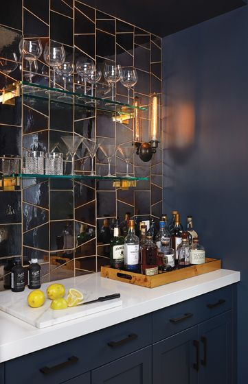 The butler's-pantry bar is a haven in dark blue with a reflective-tile backsplash from Waterworks.