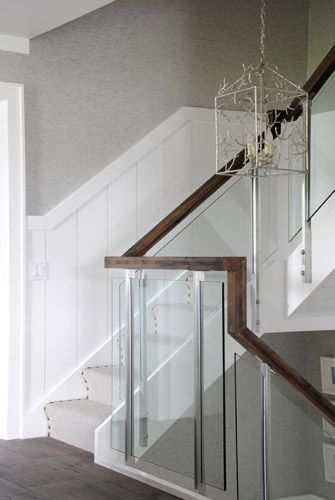 Railing Idea                                 like the glass railing in our Ayr showhome with the touchability of a wooden handrail