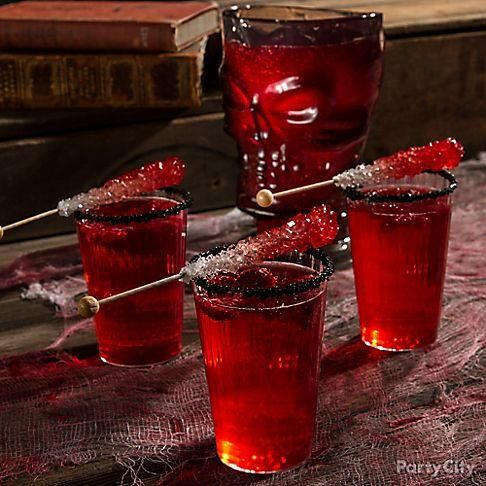 Bloody bones make the best stirrers! Mix champagne & muddled raspberries. Make your bloody bone stirrer by spraying white candy rock sticks with red food mist!