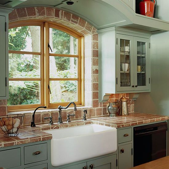 Farmhouse Sink Framed by Tumbled Marble---- looks like brick, I dont like the whole counter done in it but around the window would be cute