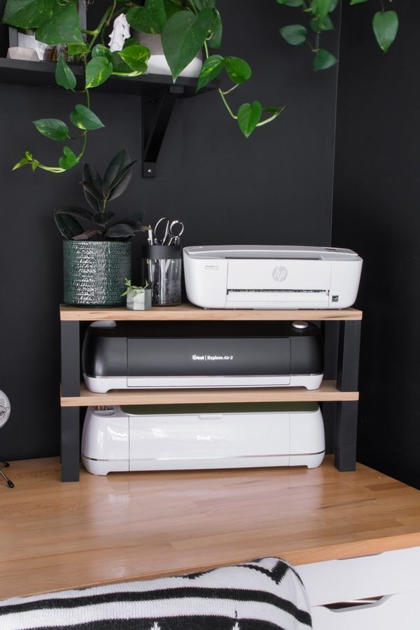 Looking for an easy DIY printer stand idea? Im sharing what I made to maximize vertical space on a desktop, plus storage for my Cricut machines!