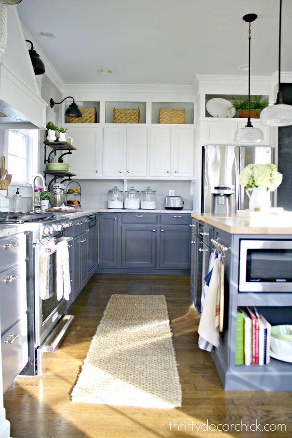 A beautiful two-toned DIY kitchen renovation. Extending cabinets and island and painting the cabinets made a huge difference!