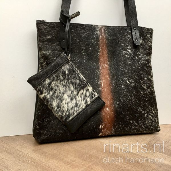 black leather tote with beautiful cow hair front. Black work bag with leopard cow hair.