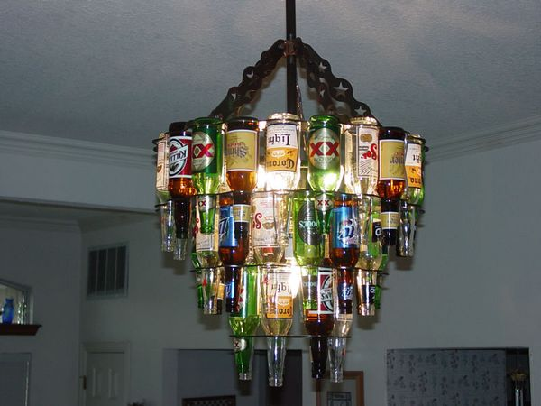 Beer bottle chandelier! Love this! I need to see if Scott can make the metal base for something like this!