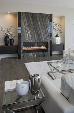 Contemporary living room with floating cabinets, fireplace with granite surround.