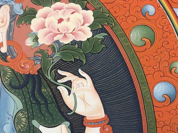 A detail of Chenrezigs hand from the thanbhochi.  #BuddhistArt #Thangka #TibetanArt #TashiDhargyal  #thanbhochi #TibetanGallery #PreserveTibetanArt #ColoringForMeditation  www.TashiDhargyal.com www.ColoringForMeditation.com www.PreserveTibetanArt.org
