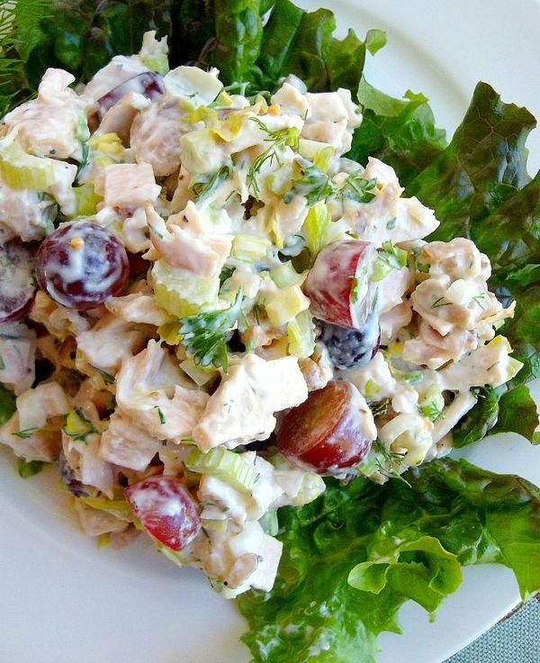 Full of flavor, this classic with a twist chicken salad recipe uses ready-to-eat rotisserie chicken, green onions, dill, parsley, grapes and walnuts.