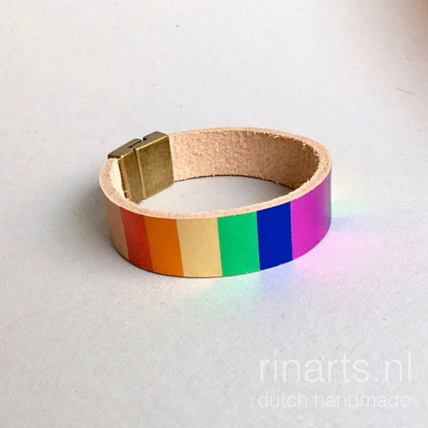 Leather bracelet made from natural veg tanned leather, with hand printed rainbow stripes.