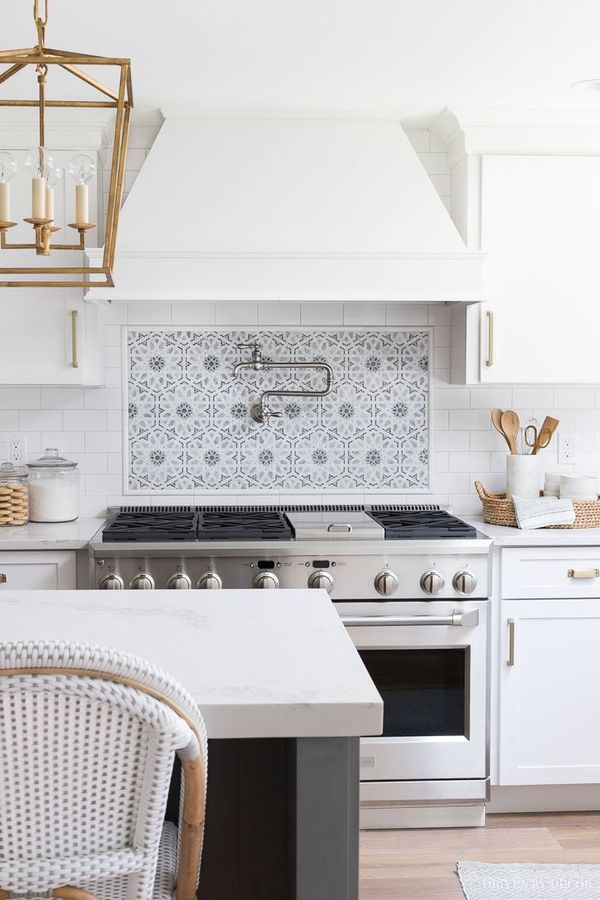 I am in LOVE with that mosaic tile accent behind the range! And that pot filler! All sources provided in the post! #kitchen #kitchens #kitchenrenovation #kitchenreno #kitchenremodel #kitchendesign #kitchenideas #lighting #tile #backsplash