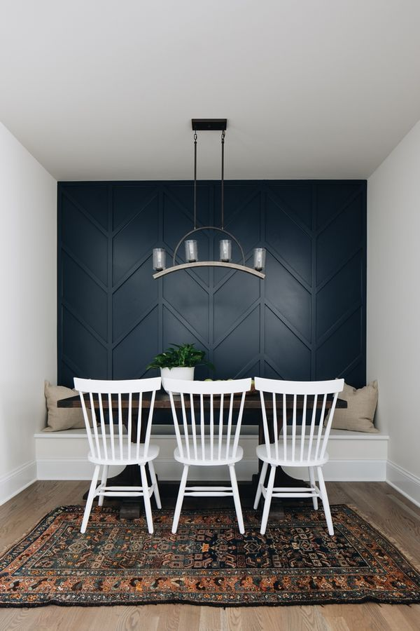 Custom accent wallDining room features a custom accent wall above banquette with chevron trim Accent paint color is Benjamin Moore Hale Navy Benjamin Moore Hale Navy Benjamin Moore Hale Navy Benjamin Moore Hale Navy Benjamin Moore Hale Navy Benjamin Moore Hale Navy Benjamin Moore Hale Navy #customwall #accentwall #BenjaminMooreHaleNavy #chevrontrim