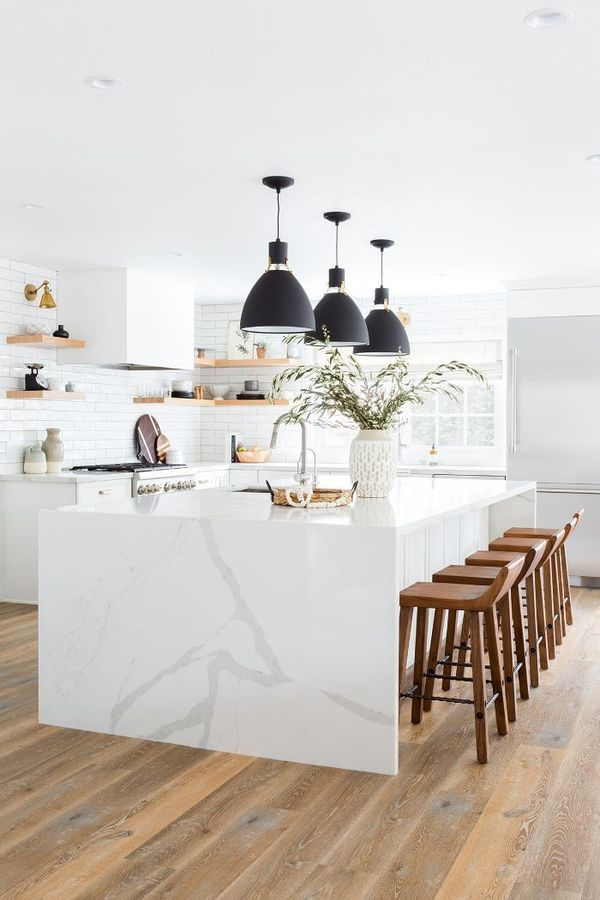 White Kitchen.After installing the massive 12-foot island, Brooke knew the counters needed to be just as special. They opted for a Calcutta gold quartz for aesthetics and durability.