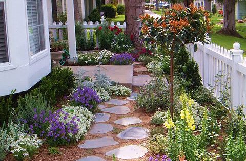 Cottage Garden. Love the stone path and casual placement of the colorful