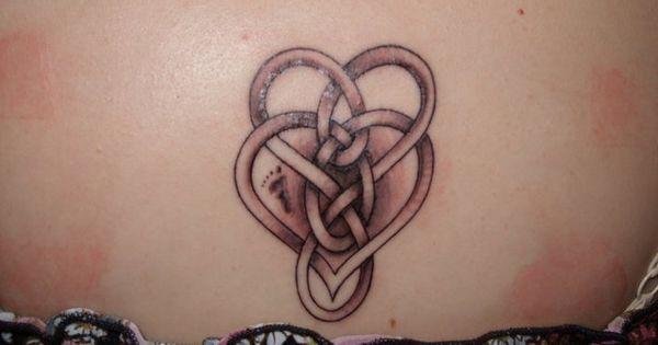 See more tattoo ideas on http://tattoosaddict.com/charming-celtic-motherhood-knot-tattoo-on-waist-275.html Charming celtic motherhood knot tattoo on